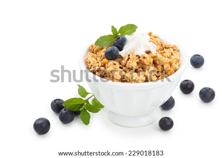 Granola with mint  and blueberries isolated on white background. - stock photo