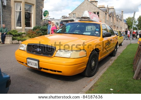 GRANTOWN ON SPEY, SCOTLAND -  SEPTEMBER 4: New York Taxi on display in the annual Motor Mania car show on September 4, 2011 in Grantown On Spey, Scotland - stock photo