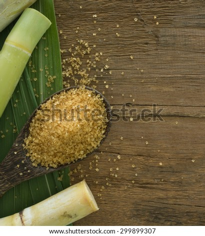 granulated brown sugar produced from sugar cane.  top view - stock photo