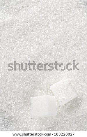 Granulated sugar and sugar cubes as background. - stock photo