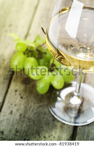 grape and wine on wooden table - stock photo