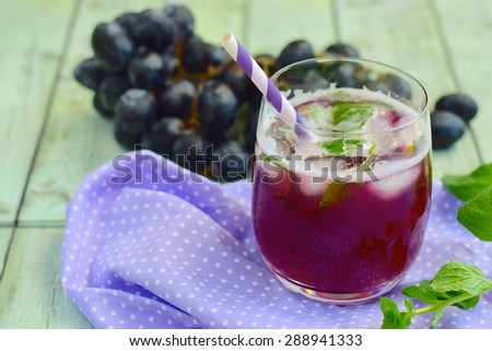 Grape mint soda mocktail with fresh grapes background - stock photo