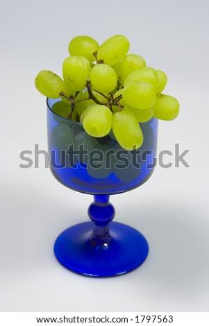 grape on blue glass - stock photo