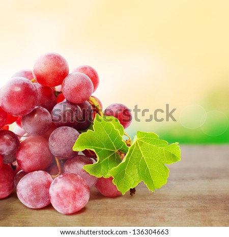 Grape on blurred nature background with copy space - stock photo