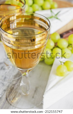 grape wine in the glass, brie cheese and grapes.selective focus.  traditional cuisine - stock photo