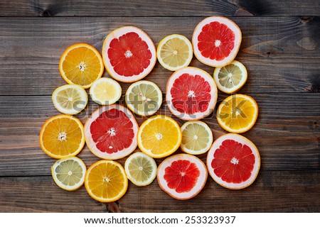 grapefruit lemon orange on a dark background - stock photo