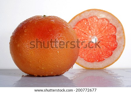 Grapefruit with slice isolated on white background  - stock photo