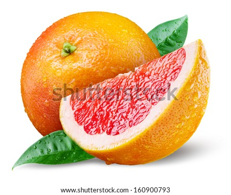 Grapefruit with slice on white background - stock photo