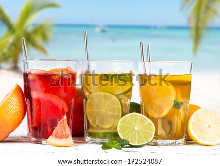 Grapefruits, lime and lemon, slice, mint ice tea on wooden background. Summer concept. Refresh drink. - stock photo
