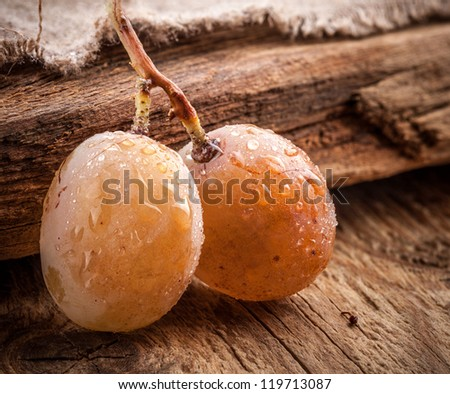 Grapes berry on grunge wooden background - stock photo