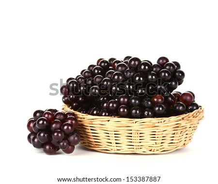 Grapes in basket on white background  - stock photo