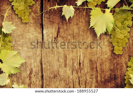 Grapes on a wooden background/   - stock photo