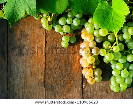 Grapes on a wooden barrel - stock photo