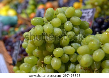 grapes on display in a supermarket - stock photo
