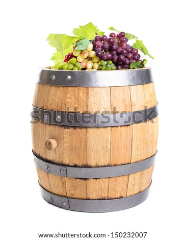 Grapes on wooden barrel with wine isolated on white - stock photo