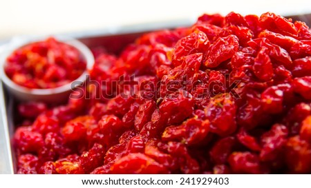Grapes, small dried red currant-like stack of trays are supplied. - stock photo