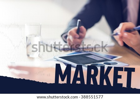 graph against business people using tablet - stock photo