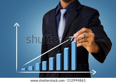graph drawing by businessman - stock photo