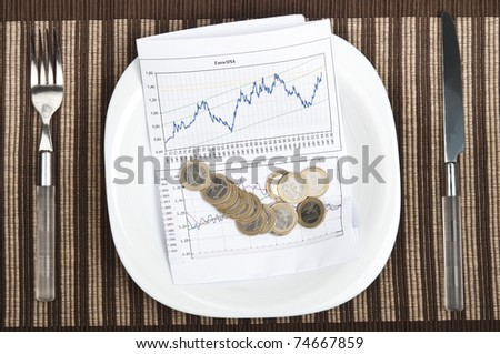 Graph on plate with fork and knife - stock photo