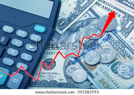 Graph showing economy strengthening of United States bank notes and coins with a calculator - stock photo