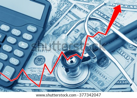 Graph showing the high cost of health care with USD bank notes a stethoscope and calculator - stock photo