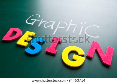 Graphic design concept, colorful words on blackboard. - stock photo