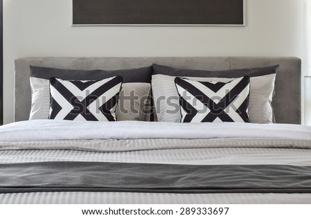 Graphic pattern pillows with modern classic style bedding - stock photo