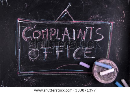 Graphic representation with chalk on blackboard written complaints office. - stock photo