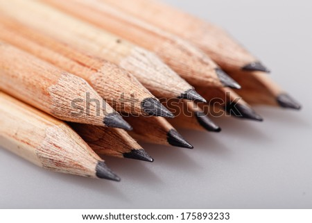 Graphite wooden pencils for sketching shot closeup background - stock photo