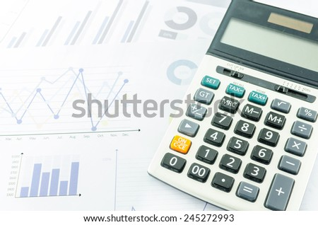 Graphs and Calculator - stock photo
