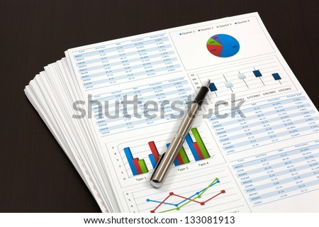 Graphs and Charts Report with pen - stock photo
