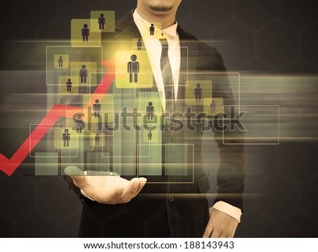 Graphs on the hands of businessmen. . business growth Concept. - stock photo