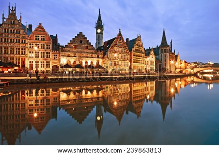 Graslei embankment in old town at dusk, Ghent (Gent), Belgium - stock photo