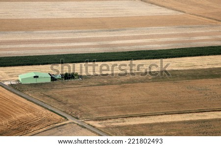grass airstrip and hangar for ultralight - stock photo