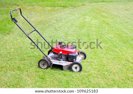 Grass cutter on a meadow - stock photo