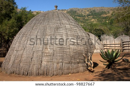 Grass hut in Swaziland southern africa - stock photo