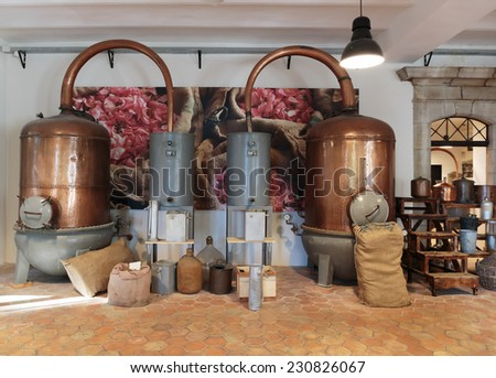 GRASSE, FRANCE - OCTOBER 31, 2014: Ancient distiller for the production of perfume in Fragonard factory - stock photo