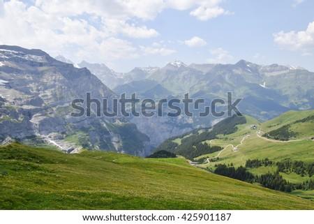 Grassy hillside mountain peaks - stock photo