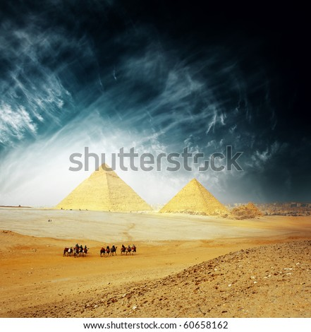 Grate Giza pyramids and group of riders on camels. Egypt - stock photo