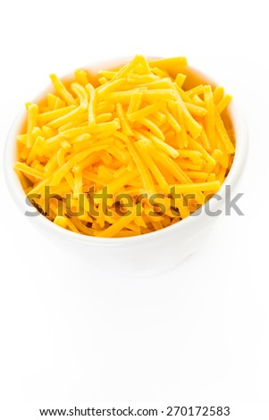 Grated extra sharp ccheddar cheese in a white bowl. - stock photo