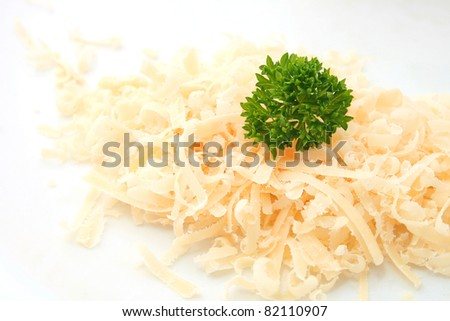Grated of traditional parmesan cheese isolated on white - stock photo