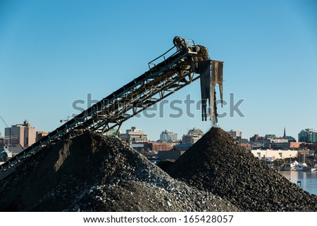 Gravel conveyor. A conveyor in a city gravel plant piles rock and gravel for use in construction work. - stock photo