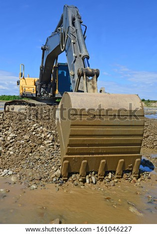Gravel excavated in the mainstream of the river - stock photo