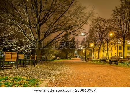 Gravel path at a city park at night - stock photo