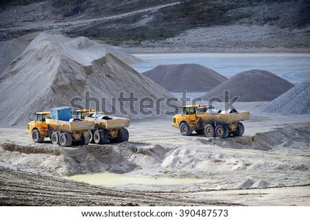 Gravel Pit Trucks in a dusty Gravel Pit - stock photo