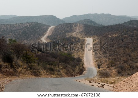 Gravel road between Opuwo and Sesfontein at Joubert-Pass, Namibia - stock photo