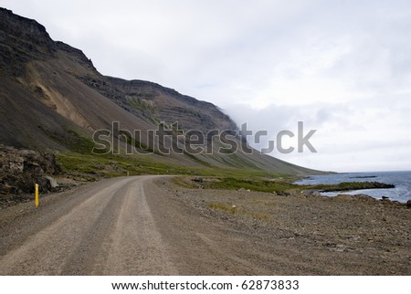 Gravel road in southern fjords, Iceland - stock photo