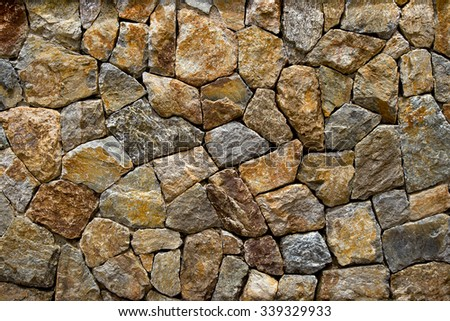 gravel small stone wall style design decorative uneven cracked real stone wall surface with cement - stock photo