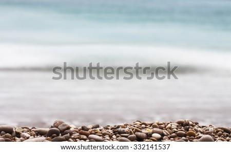 gravel with sea background - stock photo