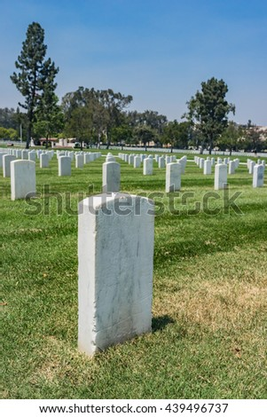 Graves in Los Angeles Military Cemetery stretch out in rows of headstones. - stock photo